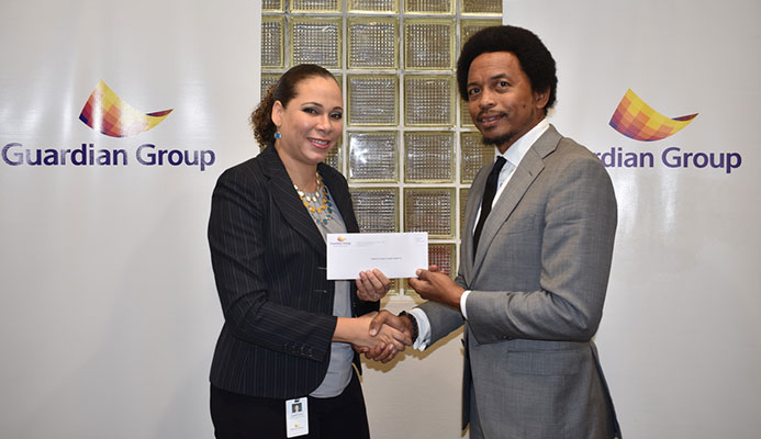 TTOC President, Brian Lewis was pres ented with a cheque from Group's Senior Manager – Group Corporate Communications, Ayesha Boucaud-Claxton.jpeg