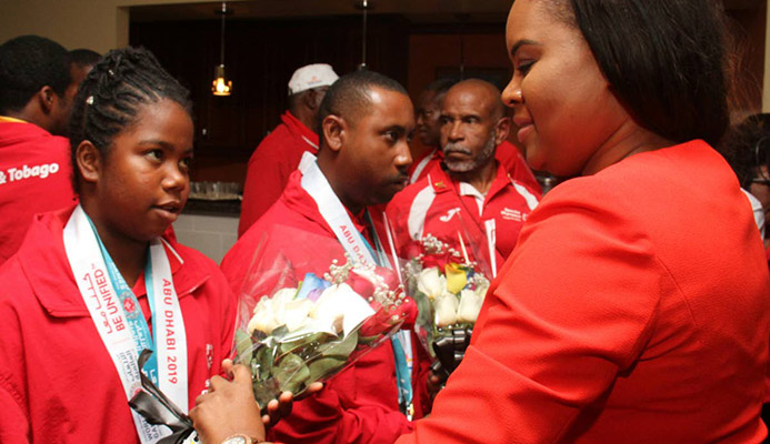 Sports Minister Shamfa Cudjoe (right) meets a member of the Special Olympics TT team during last week's reception at the VIP Lounge, Piarco International Airport.