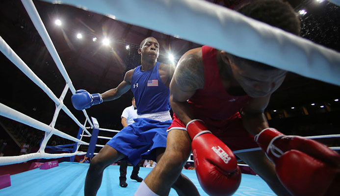 Keyshawn Davis of the US (left), throws a punch to Michael Alexzander of Trinidad and Tobago during the third round of their men's welterweightg boxing semifinal match at the Pan American Games in Lima, Peru, on Tuesday. (AP PHOTO)