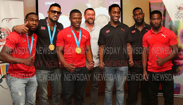 TT cyclists and staff at the TT Olympic House in Port of Spain, on Wednesday, after returning from the 2019 Pan American Games in Lima, Peru. Keron Bramble, from left, Njisane Phillip, Nicholas Paul, technical director Erin Hartwell, Jabari Whiteman, mechanic Elijah Greene and Kwesi Browne. PHOTO BY SUREASH CHOLAI