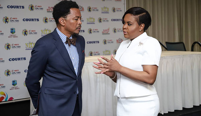 Minister of Sport and Youth Affairs Shamfa Cudjoe,right, speaks with president of the TT Olympic Committee, yesterday, at a press conference hosted by the Hero Caribbean Premier League,at Hilton Trinidad,St Ann's.