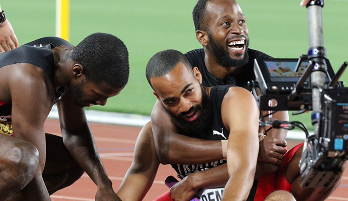 Deon Lendore hugs Machel Cedeno as they celebrate with Asa Guevara, left, after T&T 4x400 metres team copped goal at the IAAF World Relay in Yokohama, Japan, Sunday. The team won the event in a world-leading time of 3:00.81.