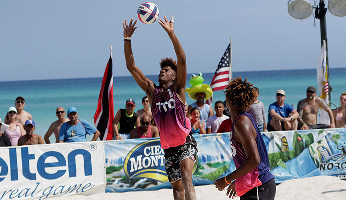 T&T's Daynte Stewart, right, sets up a pass for team-mate Marlon 'Waldo' Phillip during one of their matches on the  fourth stop of the 2019 NORCECA Beach Circuit  in the sands adjacent to the Barceló Solymar Hotel, Varadero, Cuba in May. Photo: NORCECA.