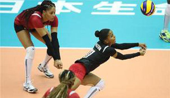 OUTSTANDING TOURNAMENT: Toco Youths' national player Afesha Olton-Humphreys, right, seen in action for T&T, won the awards for Best Digger, Best Receiver and Best Libero at the end of the Prime Minister's Premier League Volleyball Tournament. —Photo: FIVB