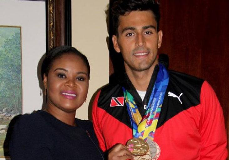 FLASHBACK: Shamfa Cudjoe, Minister of Sport and Community Development, left, and Dylan Carter at the VIP Lounge, Piarco International Airport in 2018. Minister Cudjoe holds one of the five medals earned by Carter at the 2018 CAC Games in Barranquilla, Colombia.